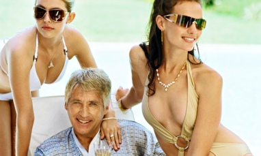 Man with two women in bikinis